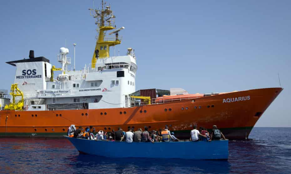 African migrants next to the Aquarius rescue ship during a search and rescue operation in the Mediterranean Sea, north of Libya