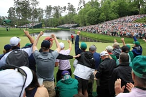 The crowd goes wild as Woods knocks in a birdie putt on the 16th green to move two shots clear at -14. This is on! The 14-times major champion is looking imperious.