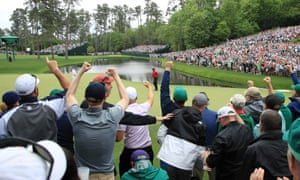 Patrons cheer as Tiger Woods takes a two shot lead.