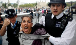 'One stereotype is true. Feminist are angry. We're not satisfied with the world as it is.' A Femen activist is detained by police in 2012 during a protest against Islamic regimes supported by the Olympic committee.