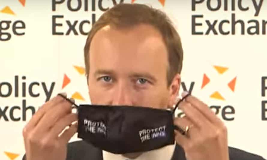 Matt Hancock puts on a face mask with the words Protect the NHS as he concludes a speech and Q+A at the Policy Exchange