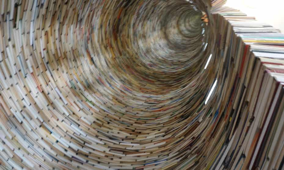 A lot to catch up with … a tower of books in the library of Prague.