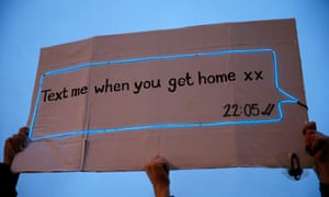 Members of the public hold up a sign reading ''Text me when you get home xx'' in Trafalgar Square during a protest against the The Police, Crime, Sentencing and Courts Bill and criticising the actions of the police at last night's vigil on March 14, 2021 in London, England.