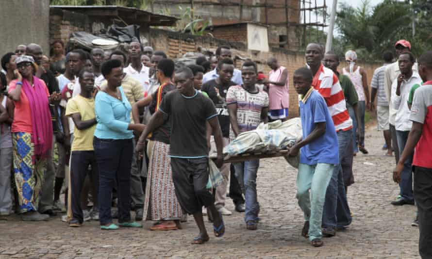 Men carry away a dead body in the Nyakabiga neighbourhood of Bujumbura, Burundi in December.