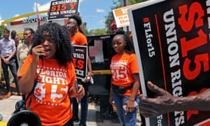 Noji Olaigbe, left, from the Fight for $15 minimum wage movement, speaks during a McDonald's workers' strike in Fort Lauderdale in May 2019.