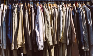 Trenchcoats hanging in clothes rack