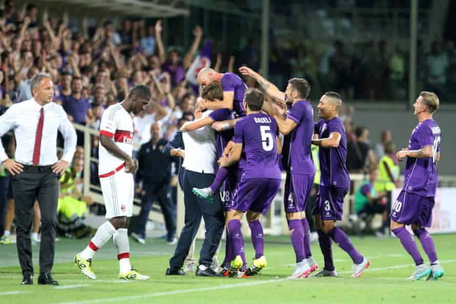 Fiorentina celebrate after taking the lead against Milan.