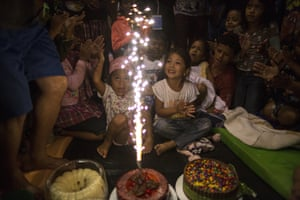 A girl celebrates her birthday among other children from the migrant caravan hoping to reach the US
