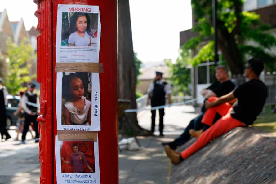 Photos of people missing after the Grenfell Tower fire taped to a post box near the scene in North Kensington, west London