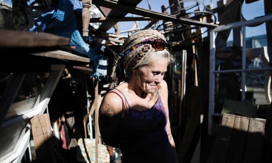 Mavin Carter-Griffin talks in her home in an encampment in West Oakland, California.