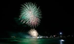 Fireworks illuminate the sky over Jeongdongjin beach in Gangneung in South Korea.