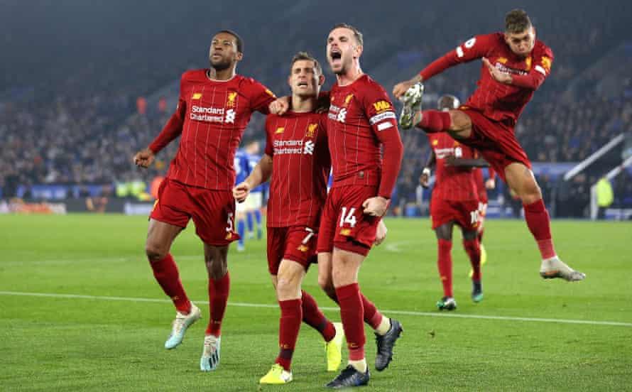 James Milner celebrates scoring Liverpool's second goal against Leicester City with Georginio Wijnaldum and Jordan Henderson at King Power Stadium on 26 December 2019.
