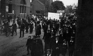 An East London Federation of Suffragettes march passes Bow bus station, June 1914.