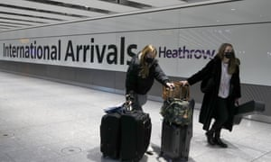 Travellers arrive at Heathrow Airport in London, Sunday, January. 17.