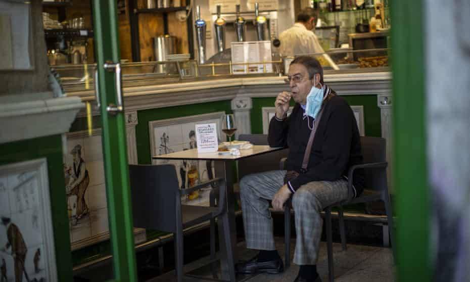 A customer sits inside a bar in Madrid on Friday.
