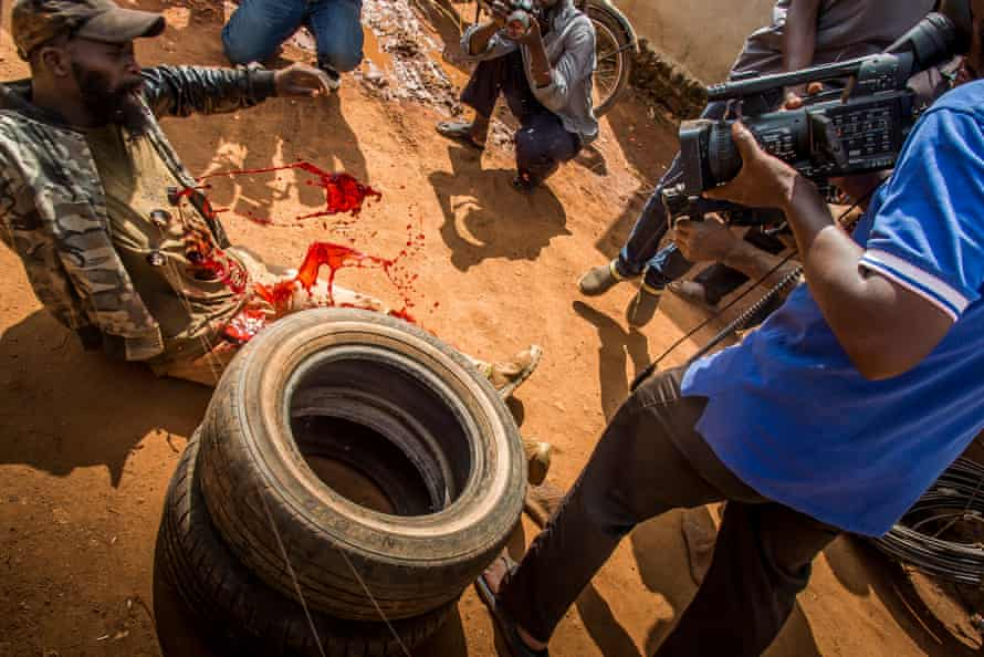 A look-like Al-shebaab villain dies in a whirlwind of blood, shot by the nice guy, in Once a soldier movie, while Isaac Nabwana the director shoots.