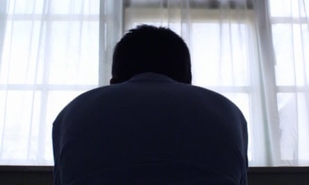 Man's silhouette at window