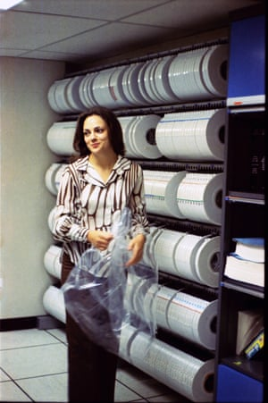 Computer operator Helen in front of spools of tape