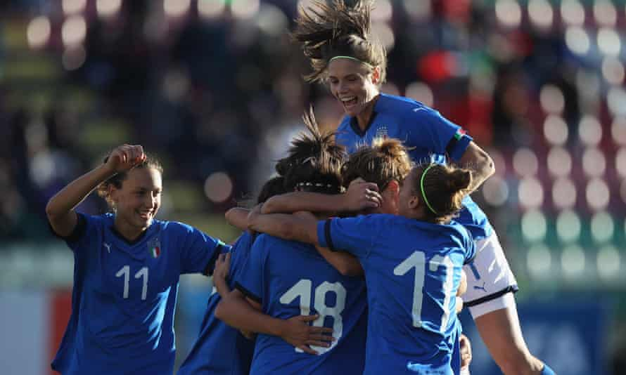 Barbara Bonansea (top) celebrates with her teammates after scoring the team's third goal during the Fifa Women's World Cup qualifier match between Italy and Romania in October