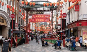 Diners eat outdoors in Chinatown in London
