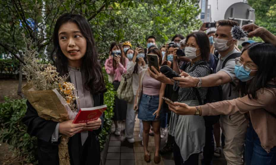 A leading figure in China's #MeToo movement Zhou Xiaoxuan, known also as Xianzi, left, speaks to journalists and supporters outside court before a hearing in her case in September.