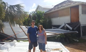 Errol and Margaret Kreymborg outside their wrecked house in Bowen