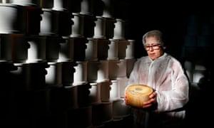 Spanish cheesemaker Paqui Diaz Pintado Borja cradles a block of manchego.