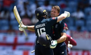 Jos Buttler and Eoin Morgan embrace on a day when both scored centuries but Chris Gayle almost pulled off a miraculous chase.