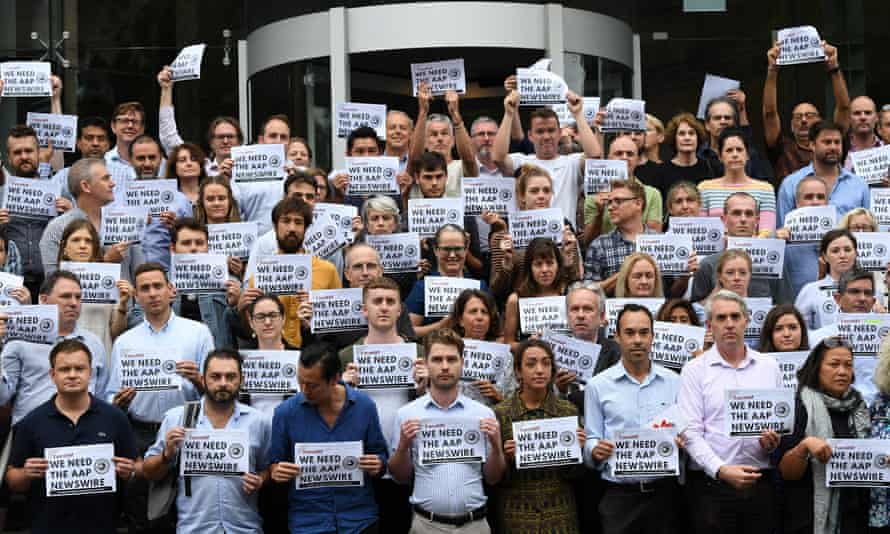 Journalists, photographers and staff from Nine hold signs in support of AAP outside Nine's offices in Sydney on Tuesday