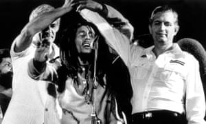 Edward Seaga, right, clasping hands with Michael Manley, left, and Bob Marley during the One Love concert at the national stadium in Kingston, Jamaica, on 22 April 1978.