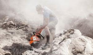 Joe Sertich, a paleontologist, cuts into the rock to liberate a fossil at Grand Staircase-Escalante.