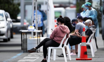 People wait at a new pop-up testing station in Auckland, after workers in the city were told to work from home on Friday following a mystery Covid case.