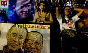Pro-democracy activists outside China's liaison office in Hong Kong demand the release of Liu Xiaobo.