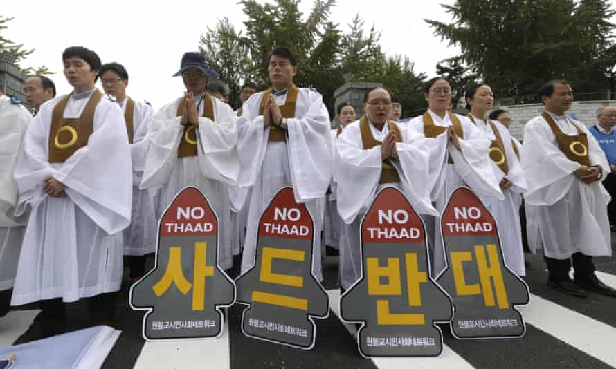 South Korean Buddhist monks pray during a rally to oppose a deployment of the Terminal High Altitude Area Defense