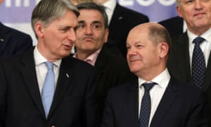 Philip Hammond talks to his German counterpart Olaf Scholz at the meeting of EU finance ministers in Bucharest.