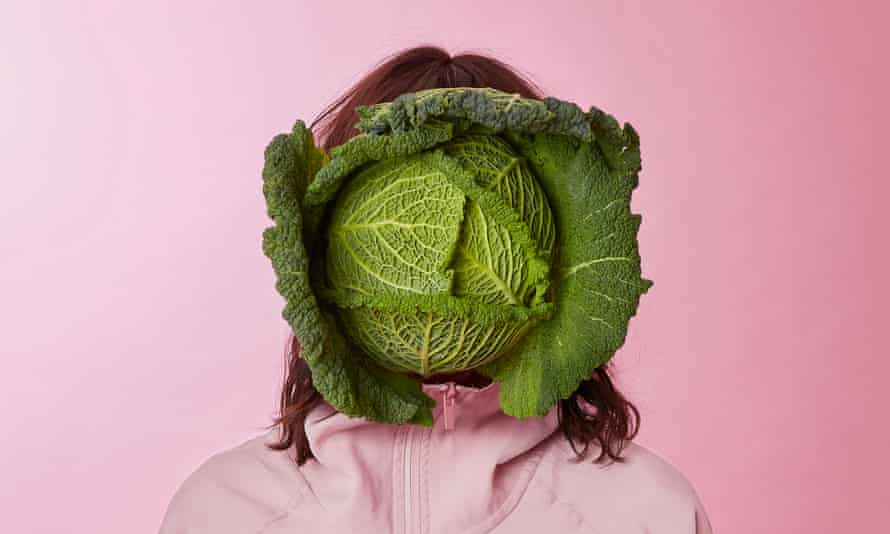 zoe williams with a cabbage over her face
