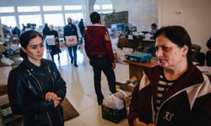 Ruzanna Arustamyan and her daughter in-law, Gohar, wait at the supplies distribution centre in the town of Goris.