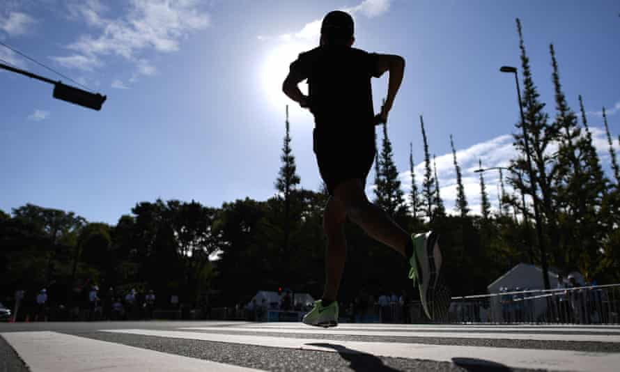 An athlete warms up before the start of a Marathon