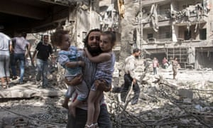 A man carries his two girls after barrel bomb attack  in Aleppo Syria.