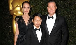 Standing together: Angelina Jolie and Brad Pitt with their eldest son Maddox. Now 14, he is co-producing the film First They Killed My Father.