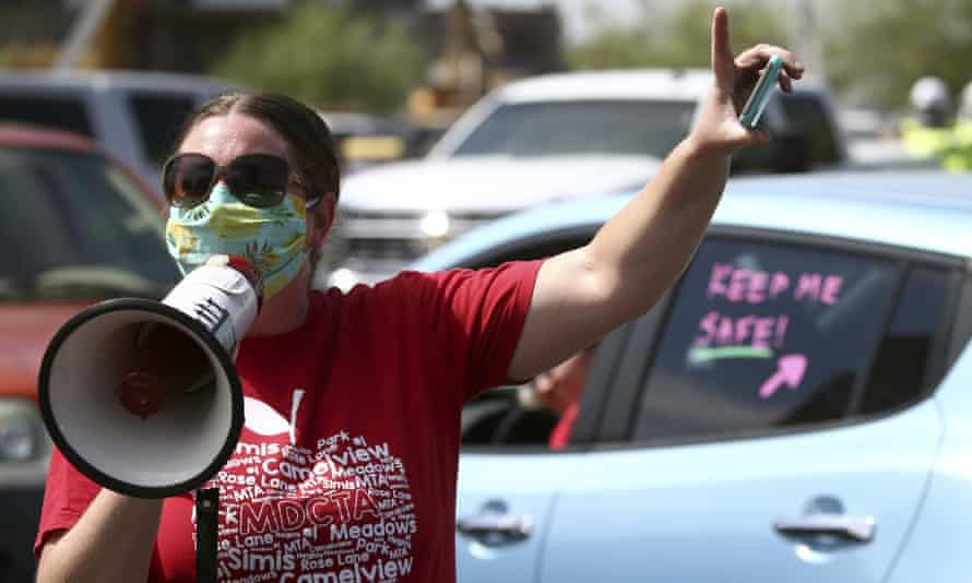 Teachers hold a '#Return2SchoolSafely' protest in Phoenix, Arizona, on 15 July.