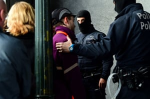 Belgian police officers carry out checks on people during an operation to limit the number of people allowed into the central Station