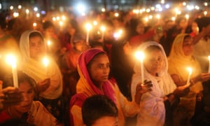 Women take part in a candlelight vigil to mark International Women's Day in Dhaka, Bangladesh.