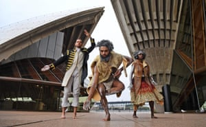 Dancers from the Bangarra Dance Theatre, Daniel Riley (L), Beau Dean Riley Smith (C), and Elma Kris (R) at a photo call on the steps of the Sydney Opera House.