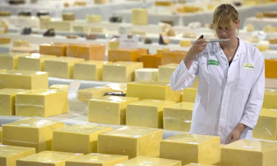 Sarah Hinchliffe, dairy technologist, samples one of the cheeses at the annual International Cheese awards in Nantwich.