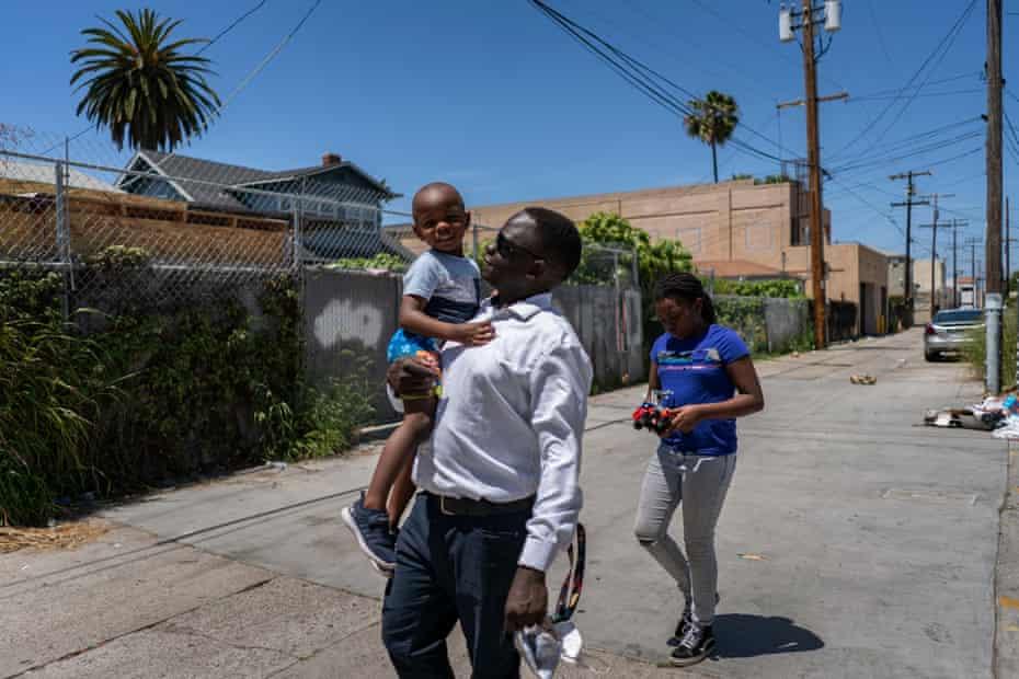 Okello takes his kids, Emily and Ezekiel, to the store to get groceries.