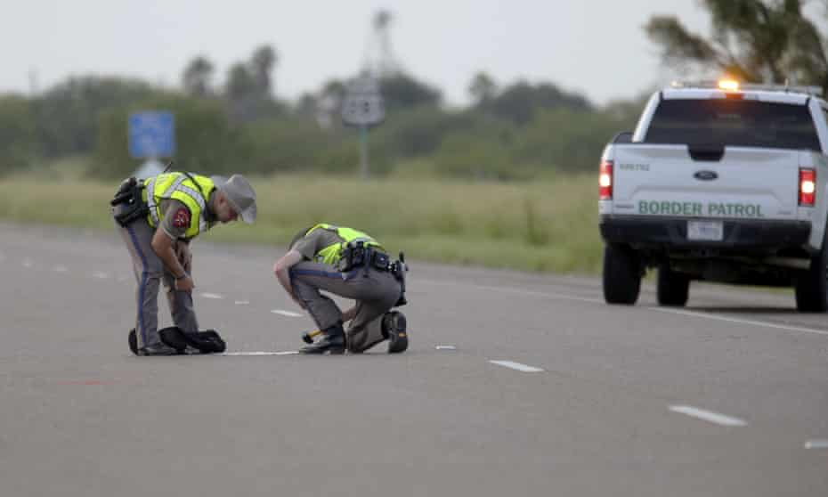 Texas department of public safety survey the area where 10 people were killed after a van carrying migrants tipped over south of the Brooks county in Encino, Texas, on 4 August.