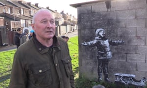 'Stressful' ... Ian Lewis admires his unsolicited Banksy in Port Talbot