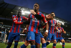 Palace's Wilfried Zaha celebrates with teammates after City's Fernandinho scored an own goal to hand them a 2-2 draw with the reigning champions.