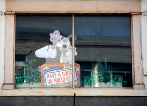 October 2020: a Wallace and Gromit sign is seen above a travel agent in Dewsbury
